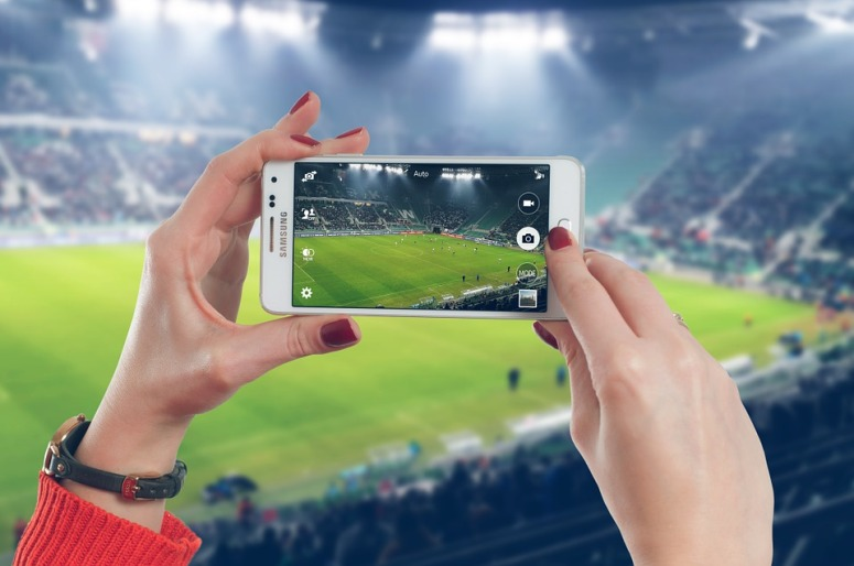 woman phone soccer game fixxedia.jpg